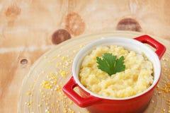 Corn perridge in red bowl Stock Photos