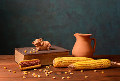 Corn and pigs figures on books Stock Photo