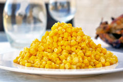 Corn on a plate as part of a dinner table set up Royalty Free Stock Image