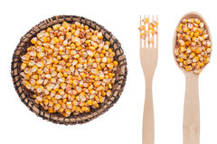 Corn in a plate, fork and spoon Stock Image
