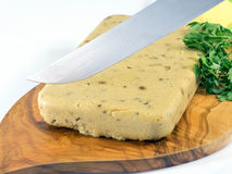 Corn polenta and mushrooms cut in slices with a knife. Corn polenta and porcini mushrooms cut in slices with a knife Royalty Free Stock Images