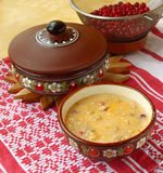 Corn porridge (banush) with a cranberry Stock Photography