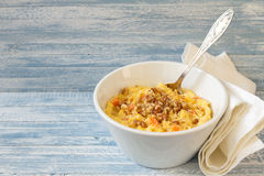 Corn porridge with pumpkin, honey and walnuts Stock Photo