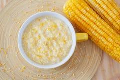 Corn porridge in yellow  bowl Royalty Free Stock Image