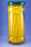 The corn preserved in a glass jar Stock Photo