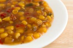 Corn relish in a white dish Stock Photo