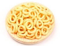Corn Rings. Snack of fried corn rings on wooden plate. On white Stock Images