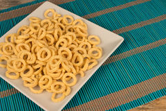 Corn rings on table Stock Image