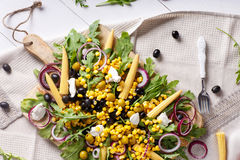 Corn salad with arugula and olives Stock Image