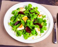 Corn salad with beetroot and goat cheese stock images