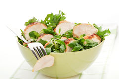 Corn salad with chicken in green bowl. Stock Image