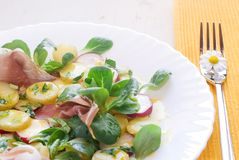 Corn salad with potatoes and ham Stock Photos