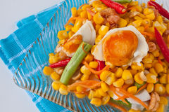 Corn salad with salted egg spicy-sour dressing. Traditional and modern thai food corn salad with salted egg spicy-sour dressing Stock Image