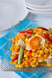 Corn salad with salted egg spicy-sour dressing. Traditional and modern thai food corn salad with salted egg spicy-sour dressing Royalty Free Stock Images