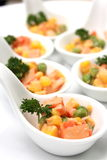 Corn salad snacks in small sampling spoons. Stock Photos
