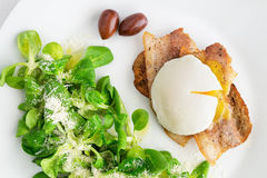 Corn salad /sprinkled with olive oil, lemon juice, and parmesan/,  and fried toast with pork slices and poached egg Stock Images