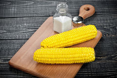 Corn and salt on a wooden table Stock Photo