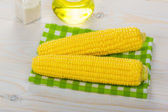 Corn and salt on a wooden table Royalty Free Stock Photography