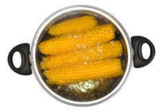 Corn in a saucepan Stock Images