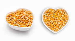 Corn seeds  in a heart shaped bowl Stock Photos