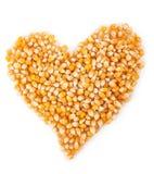 Corn seeds. Heart Stock Photos