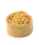 Corn seeds in rustic bowl Royalty Free Stock Image