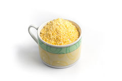 Corn semolina into a cup Royalty Free Stock Images