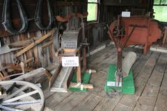 Corn Sheller - Farm Machine works displayed in the Blacksmith shop at Amish village royalty free stock photography