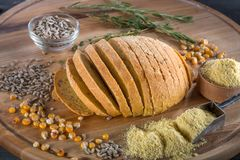 Corn sliced bread on wooden board Royalty Free Stock Photos