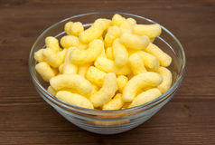 Corn snacks on bowl on wood Stock Images