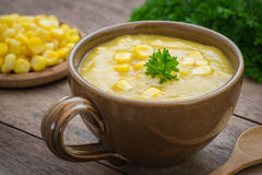 Corn soup in bowl and sweet corn on plate Stock Images