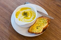Corn soup with garlic bread stock photography