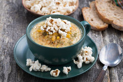 Corn soup with popcorn in cup Royalty Free Stock Images