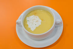 Corn Soup in white bowl on orange background Royalty Free Stock Photo