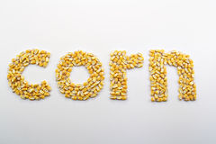 Corn Spelled Out. Kernels of corn arranged into the word corn stock photo