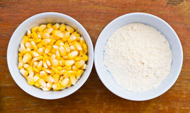 Corn and starch on wood table Royalty Free Stock Photos