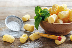 Corn sticks in a bowl and sieve with powdered sugar closeup. Stock Image