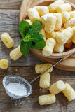 Corn sticks in a bowl and sieve with powdered sugar. Stock Photo