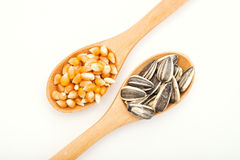 Corn and sunflower seed on wood spoon Stock Photo