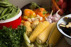 Corn. On a table with other vegetables Royalty Free Stock Photography