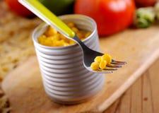 Corn in tin metal. On wood table Royalty Free Stock Photo
