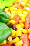 Corn and tomato salad. Corn salad with green tomato and olive oil royalty free stock image