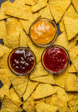 Corn tortilla chips background with dips various, top view, close up. Corn tortilla chips background with a dips various, top view, close up royalty free stock images
