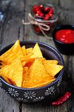 Corn Tortilla Chips or Nachos with tomato sauce on wooden table Stock Photos