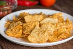 Corn tortilla chips on plate. Royalty Free Stock Photography