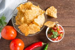 Corn tortilla chips with tomato salsa. Royalty Free Stock Photos