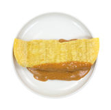 Corn tortilla filled with peanut butter on plate Royalty Free Stock Photo