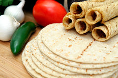 Corn Tortillas And Taquitos. Taquitos with other natural ingredients including homemade tortillas, avocados, tomatoes, small sweet onions and jalapeno chilies Stock Images