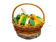 Corn vegetables and yellow leaves in basket isolated on white Royalty Free Stock Photo