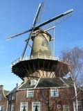 Corn Wind mill. A corn wind mill and the millers home Stock Image
